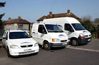 Able Roofing Contractors' vans outside a house in Thame